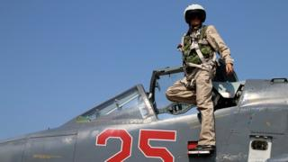 Russian army pilot poses at a cockpit of SU-25M jet fighter at Hmeimim airbase in Syria on 3 October 2015