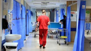 man walking in ward