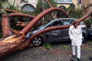 A view of a fallen tree over a car after a strong wind hit Terracina, Italy, October 29, 2018
