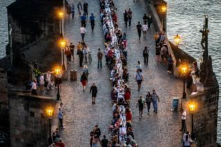 in_pictures People dine at a 500m-long table on Charles Bridge
