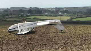 Light aircraft in field in Cornwall