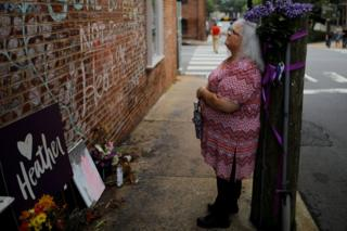 Susan Bro, mother of Heather Heyer, standing ahead of the anniversary at the place her daughter was killed