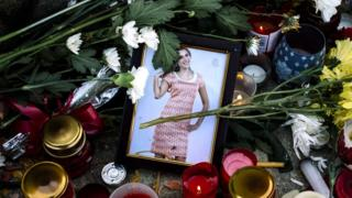Flowers and candles are placed near a portrait of slain Bulgarian television journalist Viktoria Marinova in the city of Rousse on October 9, 2018.
