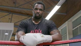 Dillian Whyte Stands in the boxing ring