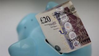 £20 note in piggy bank