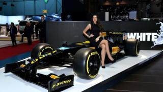 A hostess poses at the Pirelli booth during a press day ahead of the Geneva International Motor Show on March 6, 2018