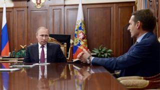 Russian President Vladimir Putin (C), meets in the Kremlin with State Duma Speaker Sergei Naryshkin (R)