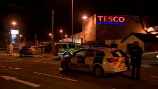 Police officers at the scene of the stabbing in Newcastle