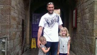 Lee Fox with his two daughters