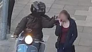 Moped riders steal woman's phone