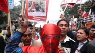 An Indian activist wearing the mask of Indian revolutionary Bhagat Singh along with other Jawaharlal Nehru University (JNU) students and their supporters participate in a protest march in New Delhi, India, 18 February 2016.