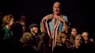 Jacob Boehme performs among audience members for his show, Blood on the Dance Floor