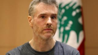 Canadian citizen, Kristian Lee Baxter, appearing at a press conference