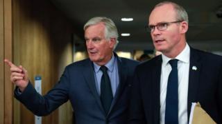 Irish Foreign Minister Simon Coveney (L) and European Union's Chief Brexit Negotiator Michel Barnier
