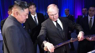 Putin shows Kim a sword