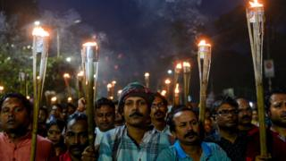 Activists and members of different organizations protest in Dhaka on November 4, 2016, against the recent attacks on Hindu temples and houses in the eastern district of Brahmanbaria.