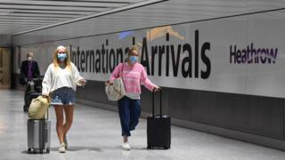 Passengers wearing face masks as they arrive at Heathrow Airport after a flight from Dubrovnik, Croatia, landed.