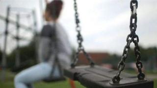 Woman on park swing