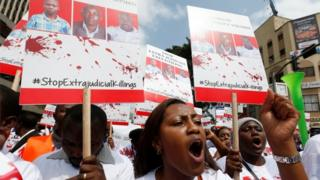 "A member of the civil society chants slogans during a protest dubbed ""Stop extrajudicial killings"" on the killing of human rights lawyer, Willie Kimani, his client and their driver in Nairobi, Kenya, July 4, 2016"