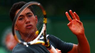 Karim Hossam playing in a boys' singles match at the French Open in 2012