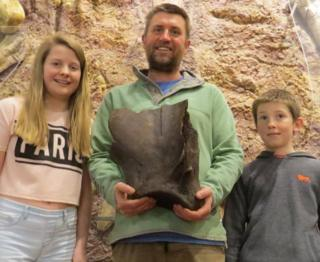 Left to right - Lily Hollingshead, Paul Hollingshead with his find, and Shay Hollingshead