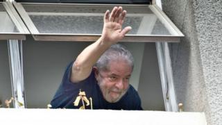 Former Brazilian President Luiz Inacio Lula da Silva waves at supporters in Sao Paulo, Brazil, on 4 March 2016.