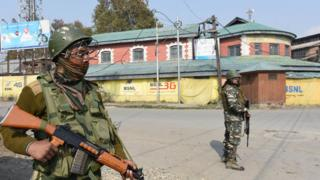 Paramilitary soldiers stand guard during a strike, on October 30, 2019 in Srinagar,