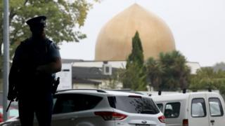 policeman stands outside a Christchurch mosque