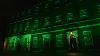 Downing Street lit up green