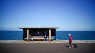People social distancing on Llandudno promenade