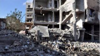 Imodoka itezwemwo bombe yononye vyinshi mu gisagara ca Homs