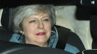 Prime Minister Theresa May leaves the Houses of Parliament in Westminster