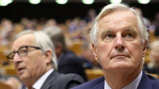 EU chief negotiator Michel Barnier (r) sat with the President of the European Commission Jean-Claude Juncker (l)