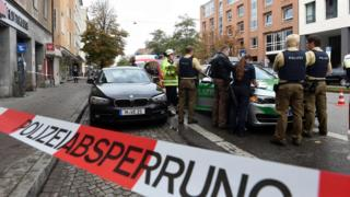German police stands inside a security perimeter set after a man attacked passersby near Rosenheimer Platz in the southern German city of Munich on October 21, 2017.
