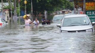 Submerged vehicles on Bihar roads