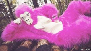 Eve dressed as a bright pink gorilla