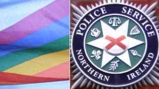 rainbow flag and psni logo