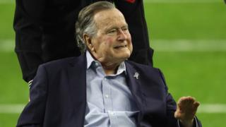 President George H.W. Bush arrives for the coin toss prior to Super Bowl 51 between the Atlanta Falcons and the New England Patriots at NRG Stadium on February 5, 2017 in Houston, Texas