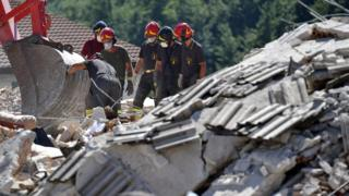 Rescue workers at the scene in Amatrice, Italy