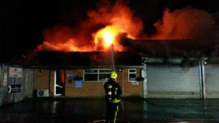 A firefighter tackling the blaze at the garage in Otterbourne