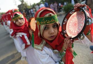A Pakistani Muslim girl takes part in a rally during Eid Milad-un-Nabi