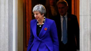 Theresa May and Philip Hammond leave 10 Downing Street
