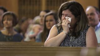 Christine Kane wipes away a tear