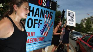 Demonstrators protest against the TPP trade agreement outside the Senate office buildings on Capitol Hill