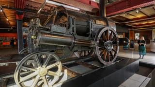Stephenson's Rocket steam locomotive sits on display at the Manchester Museum of Science and Industry