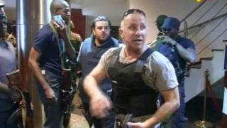 TV image taken from Mali TV ORTM, shows security officers inside the Radisson Blu Hotel in Bamako,