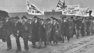 Blind marchers with campaign banners