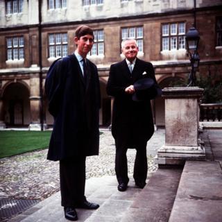 Prince Charles accompanied by head porter Mr Bill Edwards at Cambridge University