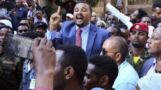 science Jawar Mohammed (C), a member of the Oromo ethnic group who has been a public critic of Abiy, addresses supporters that had gathered outside his home in the Ethiopian capital, Addis Ababa after he accused security forces of trying to orchestrate an attack against him October 24, 2019