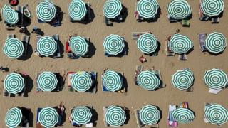 Aerial image of parasols on a beach in Albania